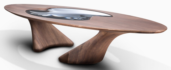 The large dining table features an oval-shaped top with a lenticular glass eye at the centre